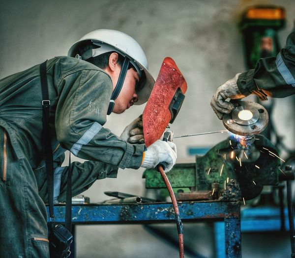welding man EyeEm Selects Metal Industry Manual Worker Factory Working Men Industry Protective Glove Occupational Safety And Health Occupation Welder