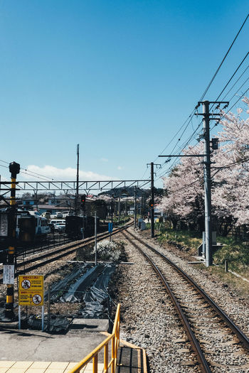 Train Rail Transportation Track Railroad Track Sky Transportation Clear Sky Nature Electricity  Cable Technology Mode Of Transportation No People Day Connection The Way Forward Electricity Pylon Public Transportation Power Line  Diminishing Perspective Outdoors Power Supply Long Shunting Yard