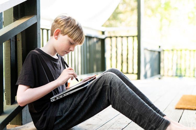 Boy sitting on book