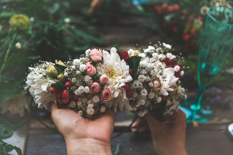 Flower Wreath Flower Flowering Plant Plant Real People Human Body Part One Person Hand Focus On Foreground Holding Bouquet Nature Flower Arrangement Human Hand Freshness Day Lifestyles Men Adult Close-up Outdoors Flower Head Wedding Ceremony