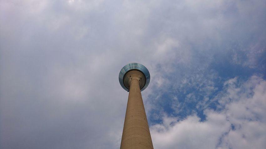 Rheinturm. Düsseldorf Germany D Medienhafen Rheinturm  Rheinturm Düsseldorf Radio Tower Funkturm Tower From Below Sky Clouds Clouds Urban Landscape Architecture Simplicity Minimalism Minimalobsession City Politics And Government Statue Ancient History Monument Sky Architecture Cloud - Sky Travel