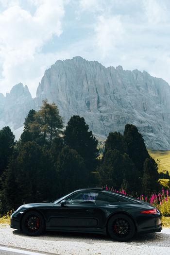 Car on mountain road against sky