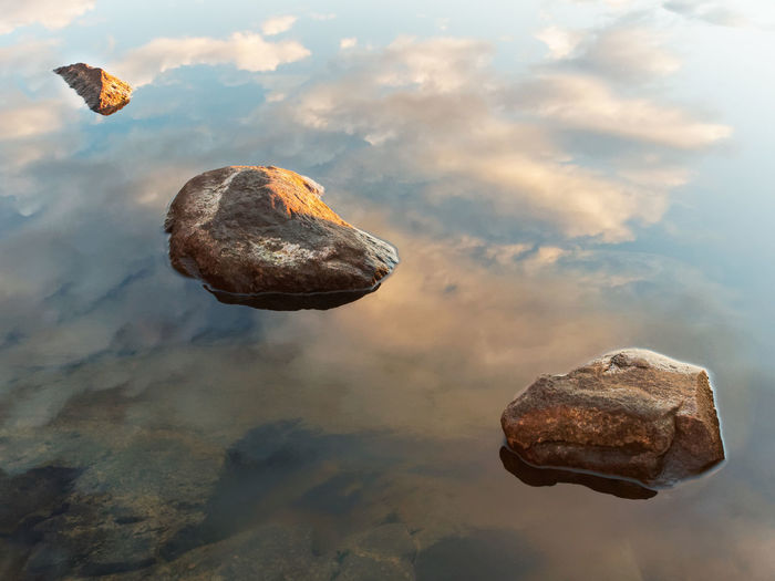 Rocks and reflection of the sky in the water. Beauty In Nature Blue Calm Clear Close-up Day Lake Majestic Mountain Nature Non-urban Scene Outdoors Reflection Rock Rock - Object Rock Formation Scenics Shallow Solitude Standing Water Stone Tranquil Scene Tranquility Water Waterfront