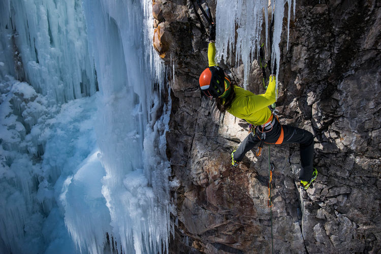 Man climbing on frozen mountain