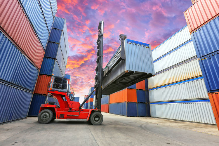 Architecture Building Business Cargo Container Commercial Dock Container Distribution Warehouse Freight Transportation Industry Land Vehicle Loading Machinery Mode Of Transportation Outdoors Pier Shipping  Stack Transportation Truck Unloading Warehouse