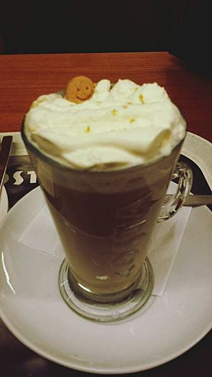 Drinking A Latte Gingerbread Smiling enjoying the Creamy bath and Warmth Relaxing Peace And Quiet Costa Coffee