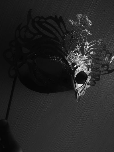 A mask, where she hide herself.