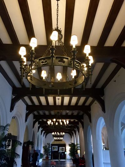 Old world architecture arched doorways beamed ceiling hanging light fixtures man made structure Indoors  Low Angle View Illuminated