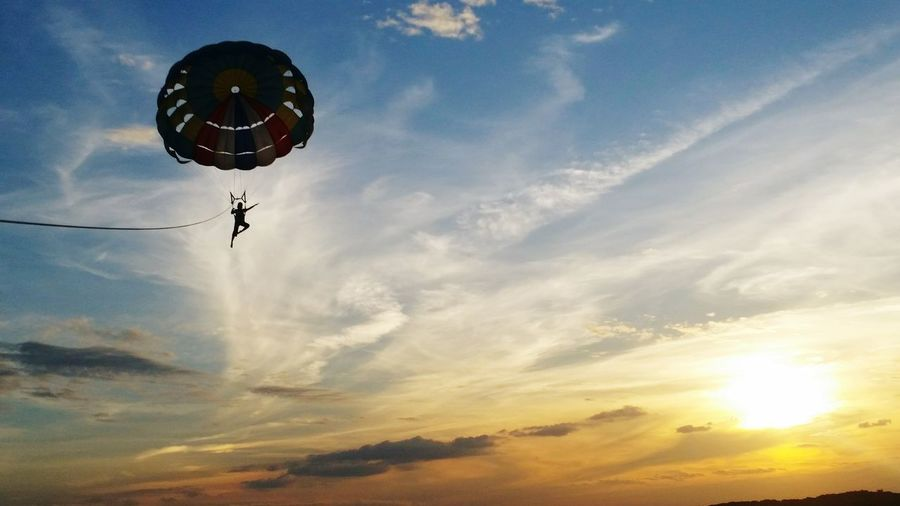 Fly me to the sun... sets Parachute Place Of Heart Live For The Story Live Sea EyeEmNewHere Love Photography Life Sun Sets Sea_collection Sea View Journey Flying Flying High Fly To The Moon Sea And Sky Fun Activity