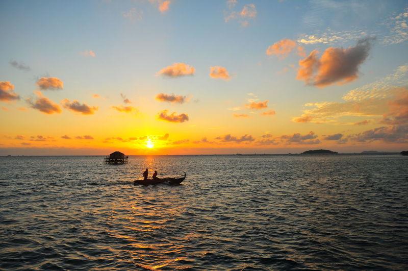 Fishing Boat Sunlight Orange Illustration Warm Summer Sunrise_sunsets_aroundworld Sunrise EyeEm Selects EyeEmBestPics Mood Water Nautical Vessel Sea Sunset Wave Sun Silhouette Dramatic Sky Sky Horizon Over Water Romantic Sky Seascape