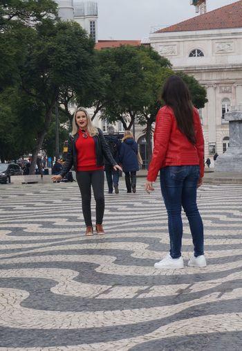 Rear view of women walking on street