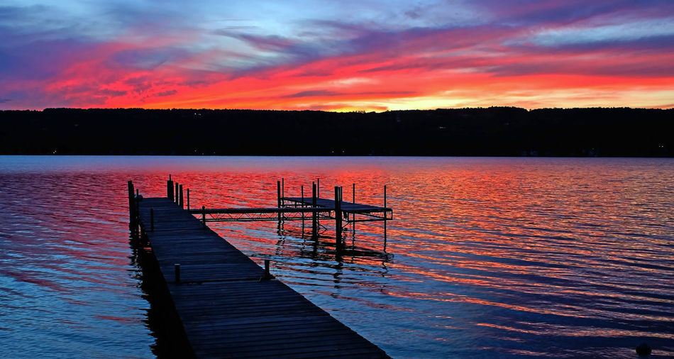 Sunset on Keuka Lake in Summer Sunset_collection Beauty In Nature Cloud - Sky Dock Dusk Evening Sky Idyllic Jetty Lake Lake View Nature No People Orange Color Outdoors Pier Scenics - Nature Sky Summer Sunset Tranquil Scene Tranquility Transportation Water Waterfront Wood - Material