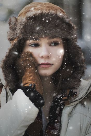 Woman Looking Away Outdoors During Snowfall