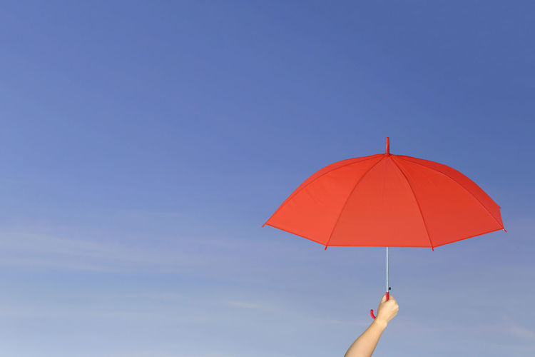 Red umbrella in hand on blue sky background concept of sun protection. Blue Sky White Clouds Leadership Is Powerful Red Umbrella Background Backgrounds Blue Sky Blue Sky And Clouds Blue Sky With Clouds Concept Conceptual Hand Handmade Leadership Leadership Change Leadership Redefined Leadershipdevelopment Protection Red Umbrellas Sun Sun Protection Sunset Umbrella Umbrellas Umbrellas In The Sky Umbrella☂☂