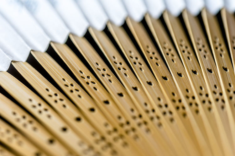 Detailed picture of the arms of a wooden fan, abstract impression, suitable as background Impression Abstract Arm Background Brown Business Close-up Corporate Business Day Detail Fan Indoors  Macro No People Pattern Patterns Selective Focus Texture White Background White Color Wooden Yellow