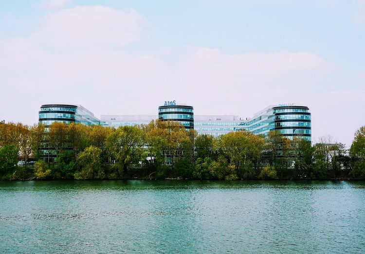 River Riverside River View Building Building Exterior Water City Tree Modern Sky Architecture Cloud - Sky Office Building Urban Scene