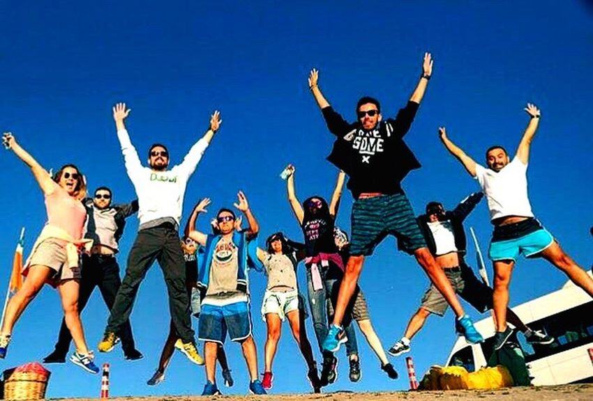 Clear Sky Togetherness Happiness Full Length Blue Low Angle View Leisure Activity Front View Friendship Mid-air Lifestyles Person Fun Young Adult Casual Clothing Teenage Boys Carefree Sky