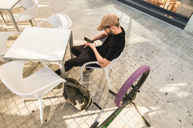 High angle view of woman sitting on chair