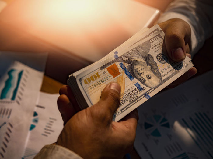 Businessmen give money to his partner, business concept. Human Hand Hand Finance Human Body Part Business Holding Currency One Person Paper Currency Men Wealth Close-up Indoors  Paper Body Part Communication Real People Leisure Activity Human Representation Finger Economy