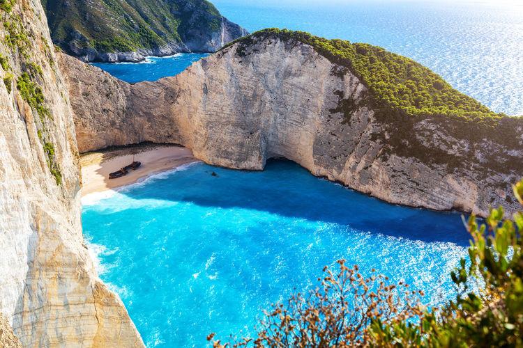 Scenic view of sea seen through rocks