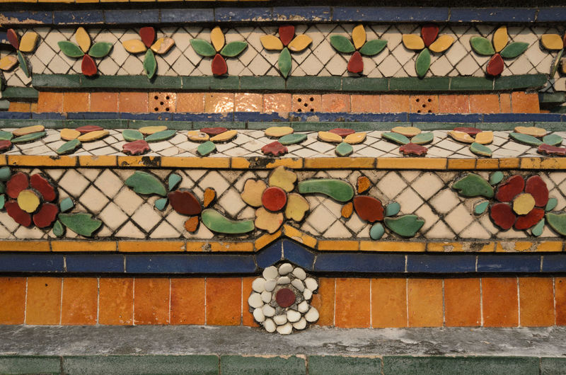 Full frame shot of colorful floral pattern tiles on wall at wat pho