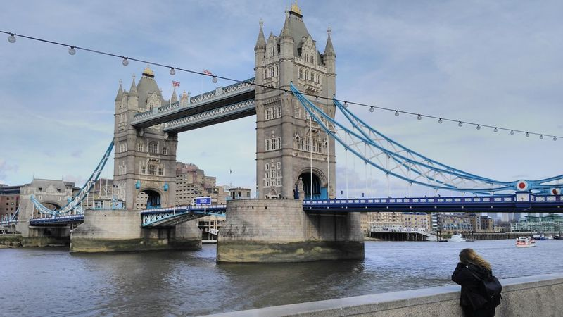 Architecture Bridge - Man Made Structure City Connection Day Engineering Landmark Outdoors Photographer River Sky Tourism Tower Bridge  Transportation Travel Destinations Water Waterfront Woman