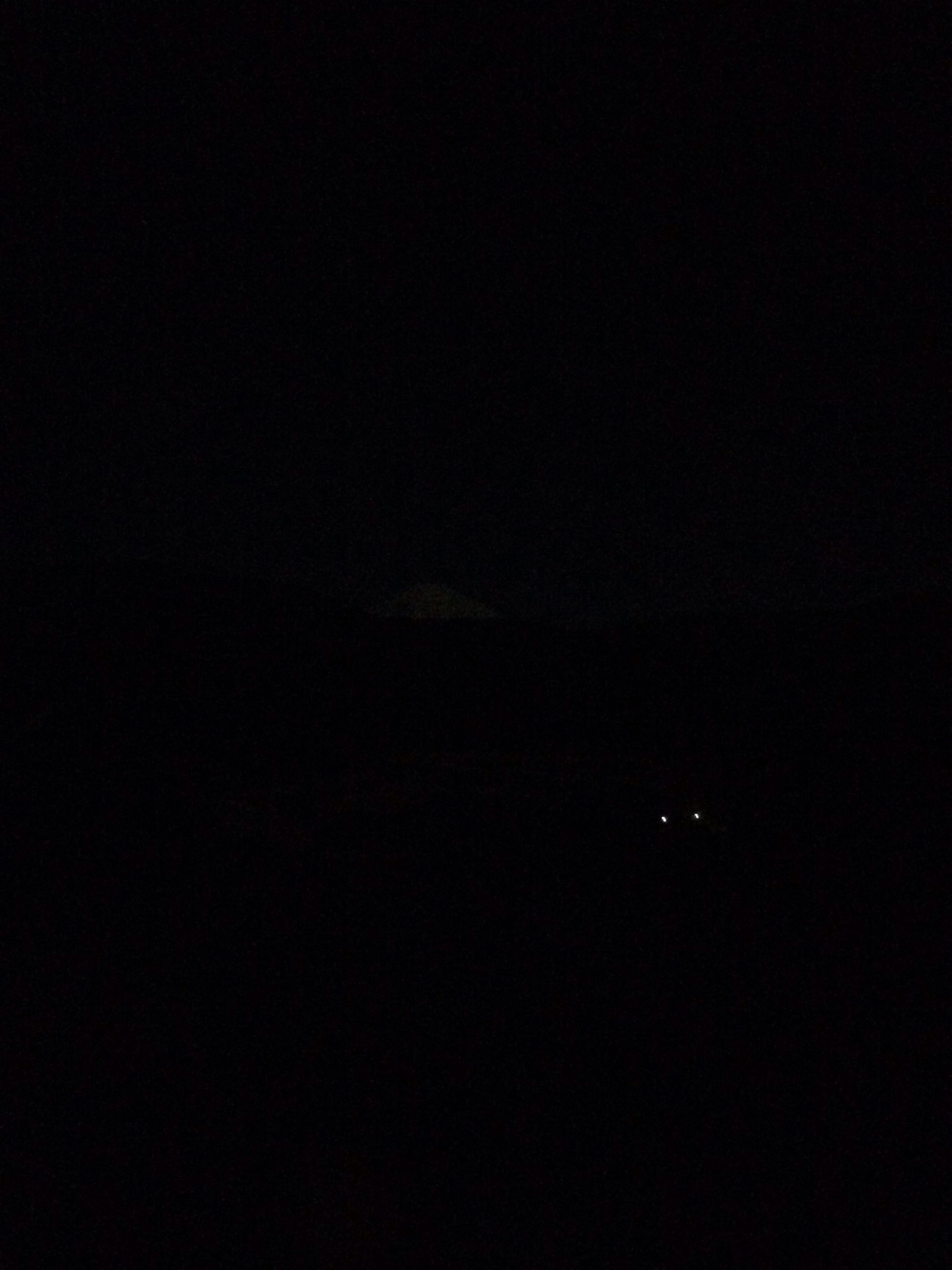 night, copy space, dark, silhouette, low angle view, mystery, illuminated, standing, clear sky, lifestyles, moon, outdoors, outline, tranquility, sky, light - natural phenomenon, nature, darkness