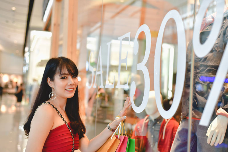 Shopping Concept. Asian girls are shopping in the mall. Beautiful women are happy to shop in the mall. Beautiful girl walking in the mall. Adult Asian  Await Background Banner Beautiful Beauty Business Buy Casual City Concrete Confident  Department Store Emotion Face Fashion Female Happiness Happy Intelligent Japan Japanese  Life Lifestyle Mall Mobile Online  Pay People Phone Portrait Purchase Relax Relaxation Sale Sell Shop Shopping Shopping Mall Shopping Online Smart Smiling Store Style Trend Trendy Using Woman Young