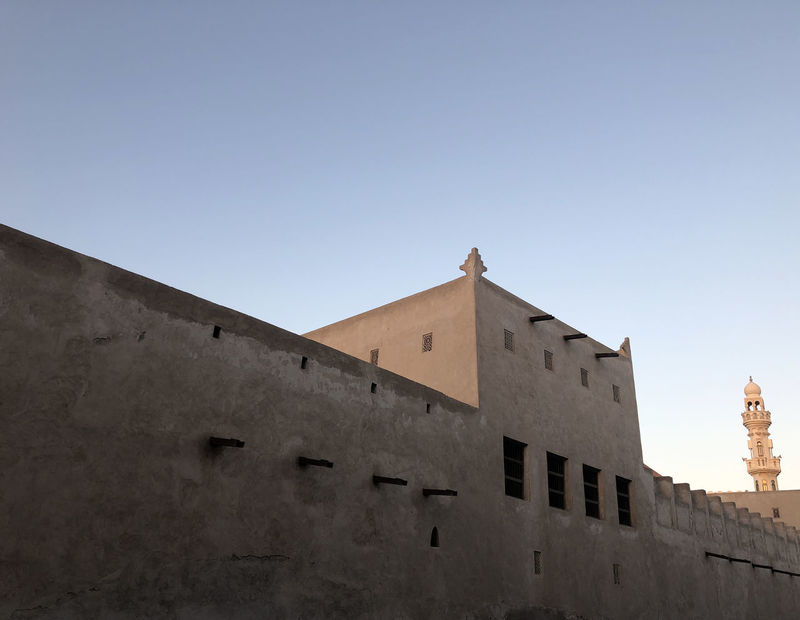 A recently-restored old house in Muharraq, Bahrain Architecture Blue Building Building Exterior Built Structure Clear Sky Copy Space Day Fort Fortified Wall History Low Angle View Nature No People Outdoors Sky Sunlight The Past Wall Wall - Building Feature