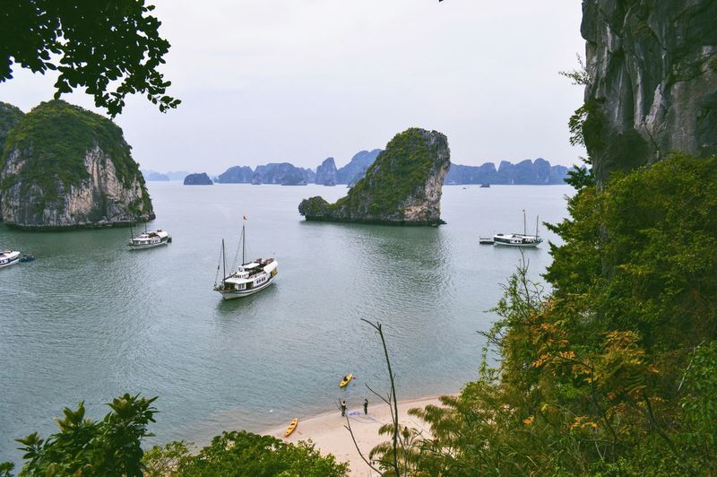 High Angle View Of Boats In Halong Bay By Rock Formations