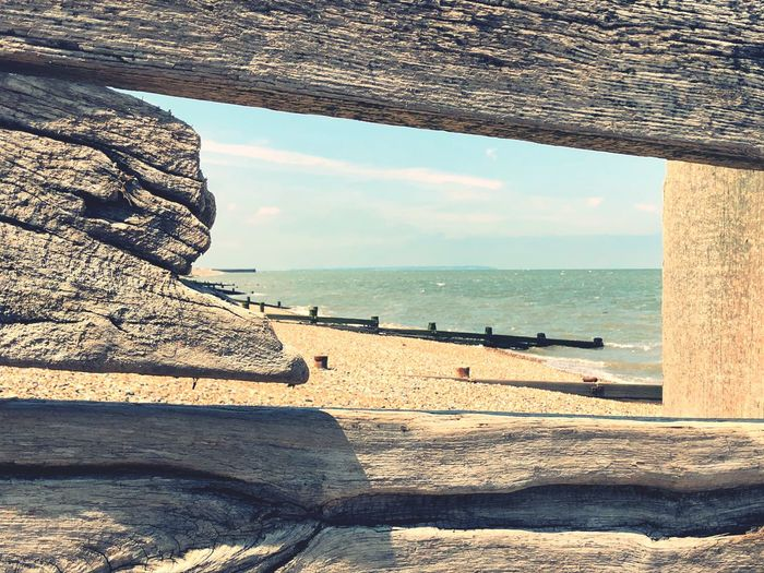 Weathered Wood Weathered Window Hole Groyne Wooden England Coastline Coast Seaside Beach Photography Pebble Beach Sea Water Sky Horizon Land Beach Tranquil Scene Outdoors