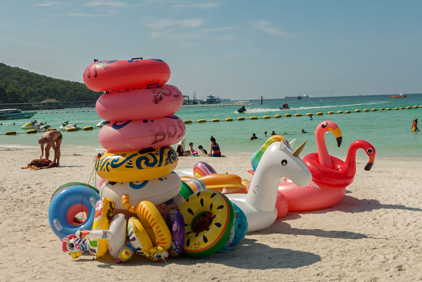 KOH LARN, THAILAND - OCTOBER 23, 2016: A beach This is one of the nice beaches of Koh Larn on a sunny day. This place is a small island in the Pattaya area and a favorite place of many tourists. ASIA Thailand Beach Beauty In Nature Day Horizon Over Water Inflatable Ring Island Koh Larn Multi Colored Nature Nautical Vessel Outdoors Sand Scenics Sea Sky Sunlight Vacations Water