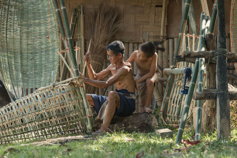Farmer with son are weave Bamboo at countryside,Llifestyle farmer in Asia,Thailand. Bamboo Grove Farmer Farmers Market Thailand Weave Adult Adults Only Bamboo Day Full Length LLifeStyle_at_Myanmar Llifestyle Men Mid Adult Outdoors People Sitting Togetherness Two People Working