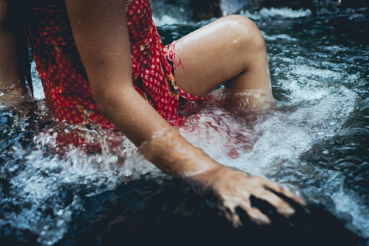 Midsection of woman in river