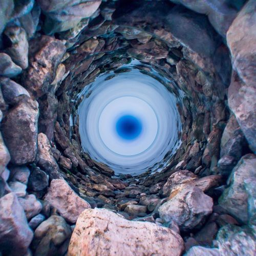 Turbine Turbine Sasso Mare EyeEm Selects Nature No People Rock Geometric Shape Solid Shape Rock - Object Hole Outdoors Natural Pattern Circle Blue