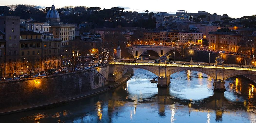 High angle view of tiber river in illuminated city