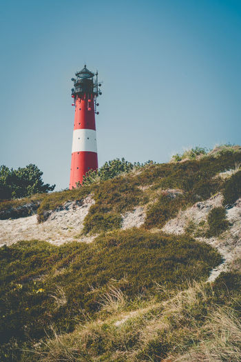 Architecture Building Building Exterior Built Structure Clear Sky Day Direction Grass Guidance Land Lighthouse Nature No People Outdoors Plant Protection Safety Security Sky Sylt Tower