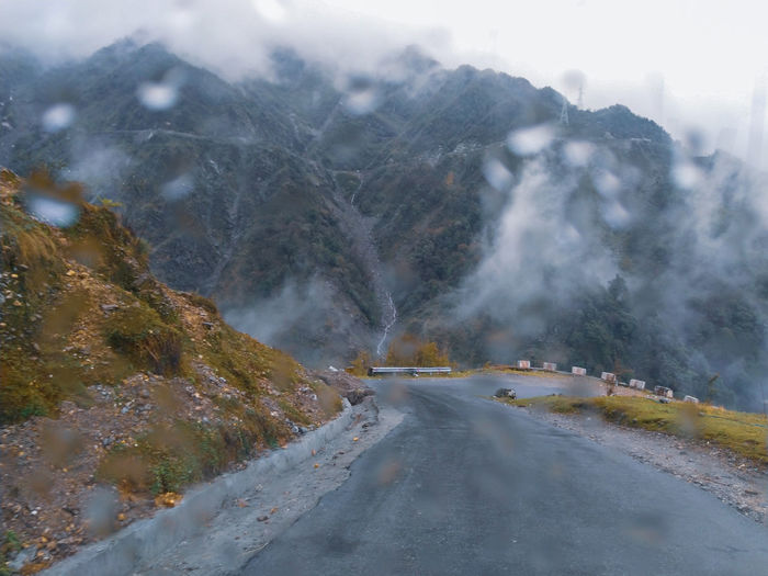 Road amidst mountains during winter