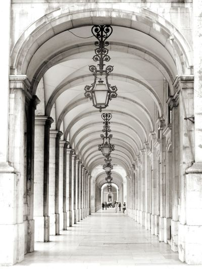 Repetition Architecture Architectural Column Imperial Old Style Art Deco Old Lamp Lamp Black And White Photography Grey Scale Repetition Hall Hallway City Arch History Architectural Column Architecture Built Structure Historic Passageway Building Wall Lamp The Way Forward Diminishing Perspective Narrow Arched Corridor
