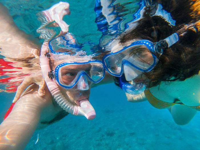 Couple snorkeling underwater and having fun in the Red sea Couple Exploring Man Snorkeling Summer Vacation Swimming Woman Blue Water Eyewear Fish Jellyfish Leisure Activity Lifestyles Nature Outdoors Real People Red Sea Sea Snorkel Snorkeling Swimming Swimwear UnderSea Underwater Water