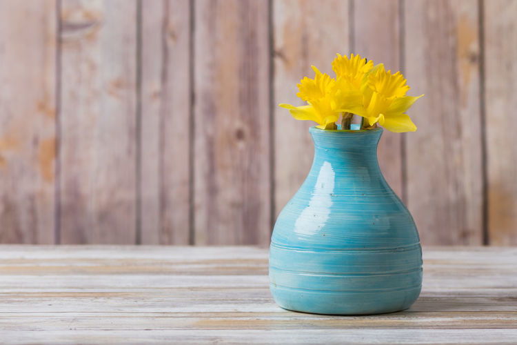 Daffodil flowers in an old blue pottery vase Pottery Vases Rustic Blue Vase Blue Vase And Flowers Daffodil Daffodils Daffodils Flowers Old Still Life Vintage