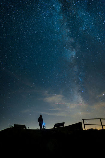 Low Angle View Of Silhouette Person Standing Against Star Field