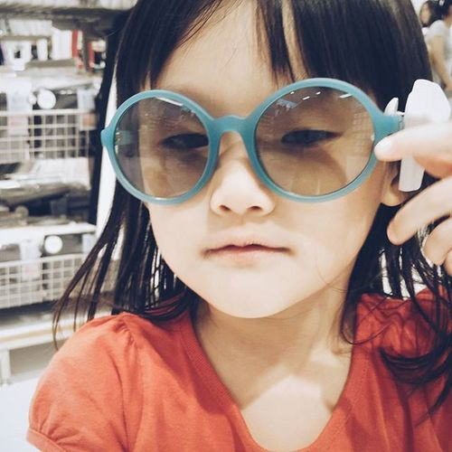 Playful Cute Little Girl Asian  Chinese Child Wearing Glasses Big Frame Eye Glasses