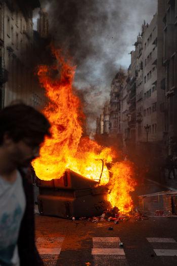 Bonfire on street in city