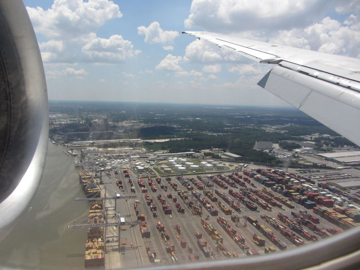 Flying over cargo with cargo Aerial View Airplane Cargo Container Commercial Airplane No People On The Move Sky Transportation Vehicle Part