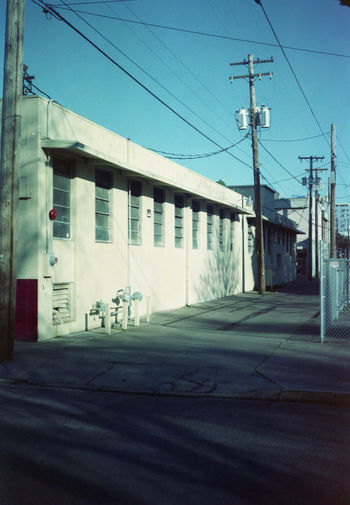down the alley Film Vintage Camera Expired Film Kodacolor200 Kodak Film Photography Electricity Pylon Telephone Line Cable Sky Architecture Building Exterior Built Structure