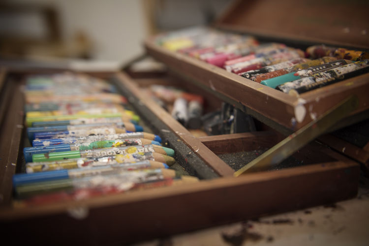 Close-Up Of Colored Pencils In Wooden Box