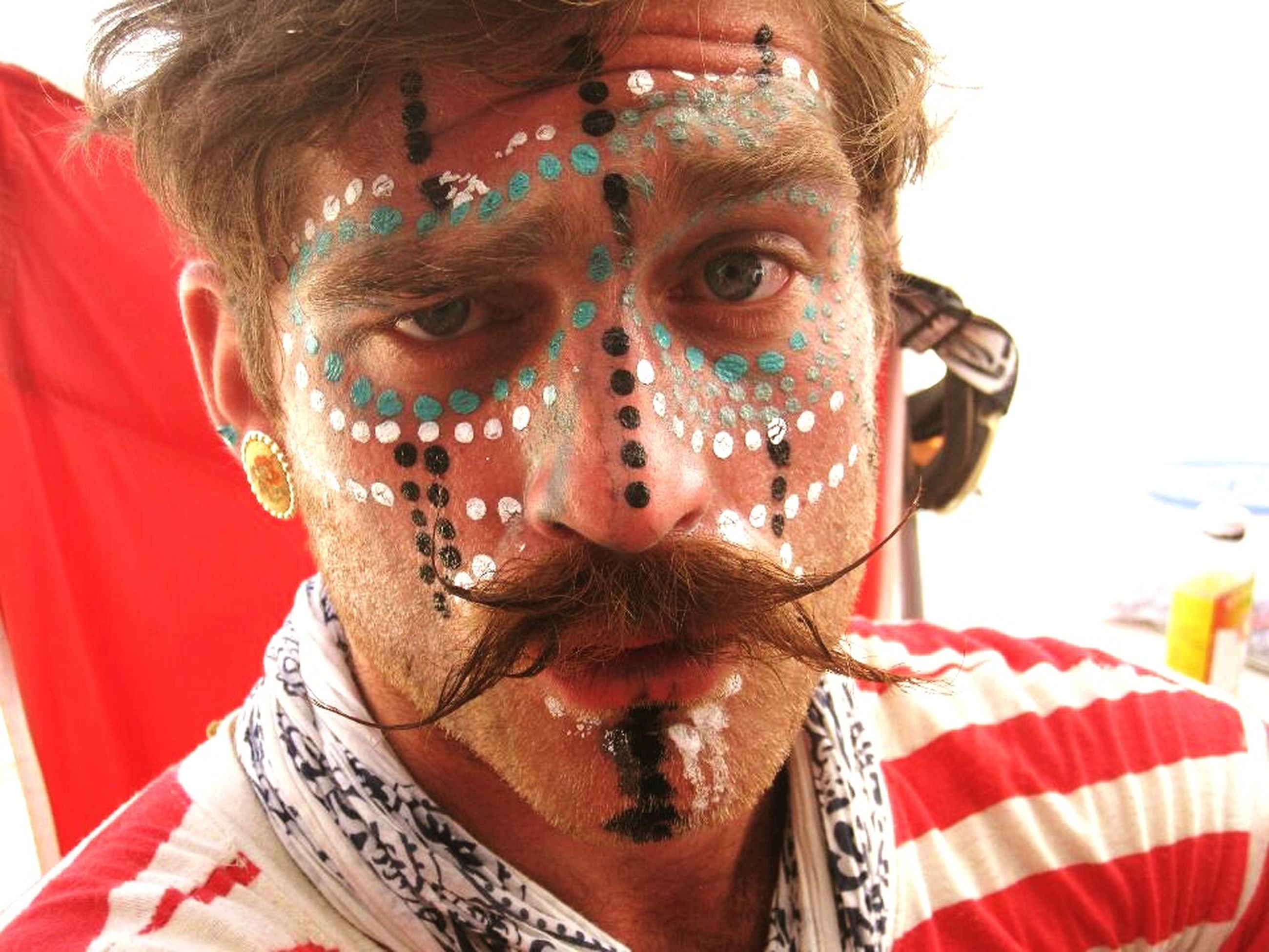 portrait, looking at camera, close-up, creativity, art, art and craft, front view, tradition, red, animal representation, human representation, cultures, headshot, focus on foreground, celebration, one person, mask - disguise, humor, sculpture, costume