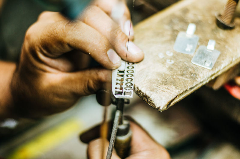Close-up of jeweller working in workshop
