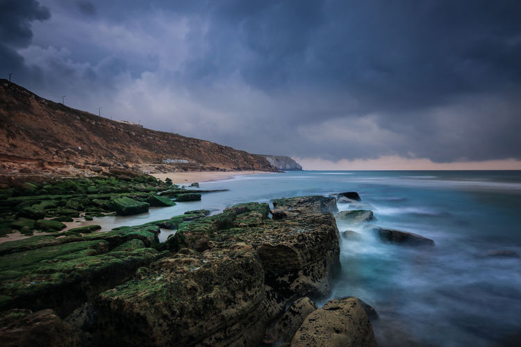 Storm in a beach Coastline Portugal Storm Wave Beach Beauty In Nature Cliff Cloud - Sky Clouds Clouds And Sky Day Fall Landscape Long Exposure Nature No People Ocean Outdoors Rocks Scenics Sea Seascape Seaside Sky Water